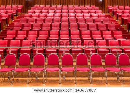 Red color theatre chair in conference room - stock photo