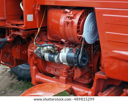 Red color tractor diesel engine air cooling close up.