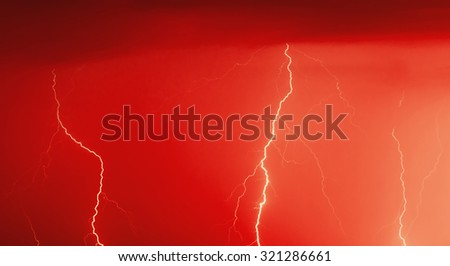 Red colored image of lightning bolt hits - stock photo