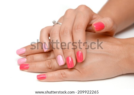 red colored manicure - stock photo