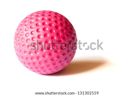 Red colored Mini Golf ball on an isolated background - stock photo