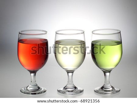 Red, Colorless, and Green liquid in the glass - stock photo