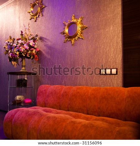 Red comfortable sofa in barbershop interior with mirrors - stock photo