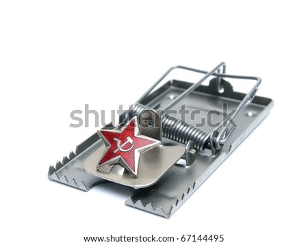 Red communist star on the mousetrap isolated on a white background. - stock photo