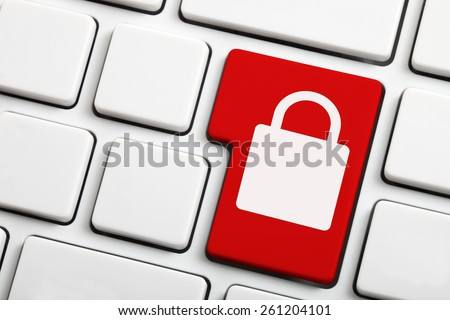 Red computer key with lock icon - stock photo