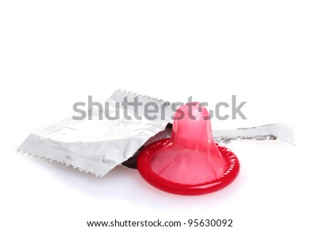 Red condom with  open pack isolated on white - stock photo