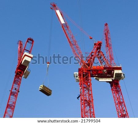 Red Construction cranes - stock photo