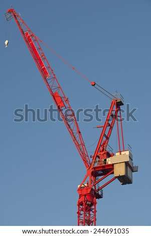 Red Construction Site Crane - stock photo