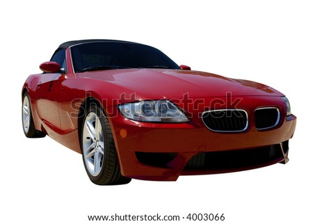 Red convertible sports car roadster  isolated on a white background. Clipping path included. - stock photo
