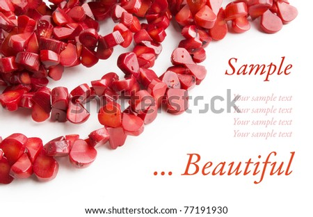 Red coral necklace frame on white background with sample text - stock photo