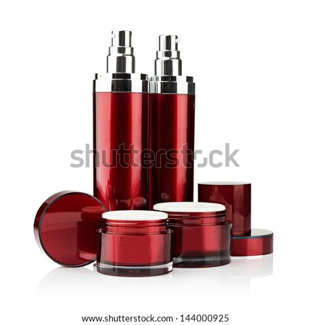 Red cosmetic cans of moisturizer isolated on white - stock photo