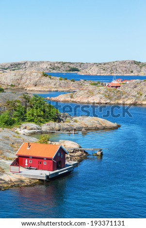 Red cottage by the sea on the archipelago - stock photo