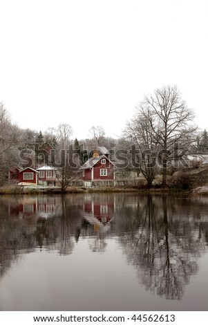 red cottage in frosty landscape - stock photo