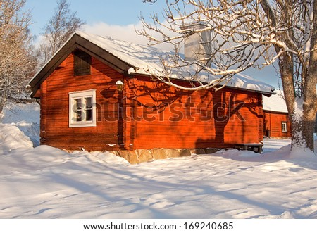 Red cottage in winter.