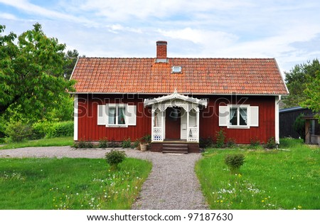 Red cottage. Typical swedish summer house. - stock photo