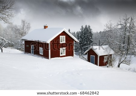 red cottages in winter, snow and ice, smaland sweden - stock photo