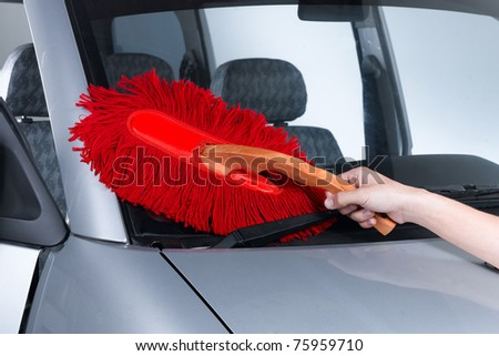 Red cotton duster for cleaning a car