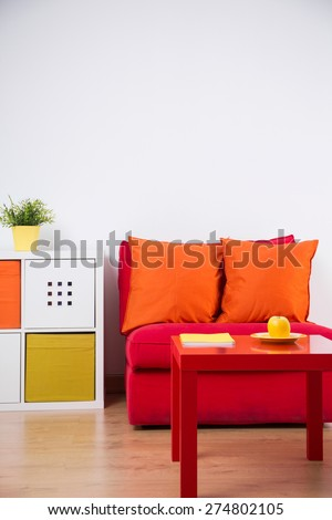 Red couch in color teenager bedroom interior - stock photo