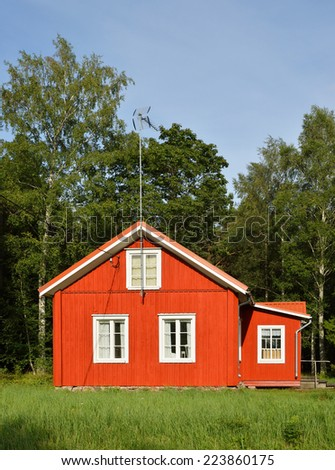 Red country house, Finland - stock photo