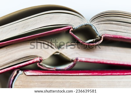 red covered opened old books