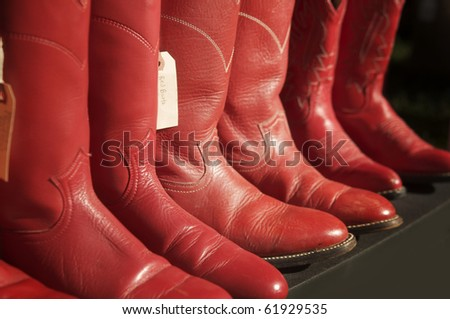 Red cowboy boots in a row - stock photo