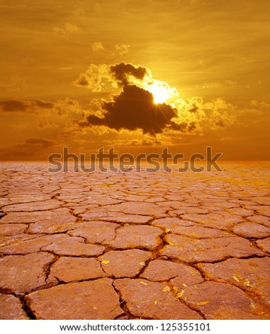 red Cracked Earth - industrial waste  dramatic sunset over drought land