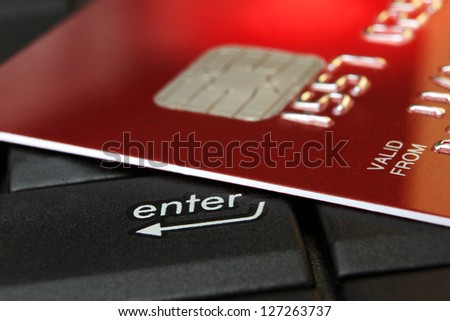 Red Credit Card on a Computer Keyboard