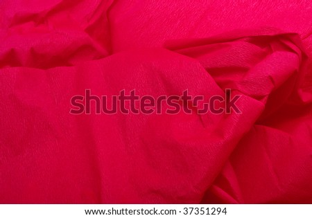 Red crepe paper christmas background / texture