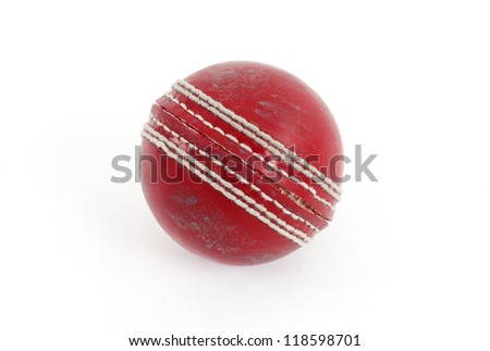Red cricket ball isolated on a white background.