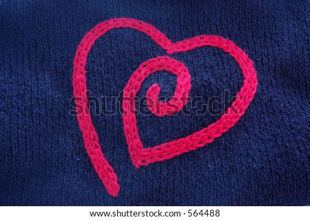 Red crocheted heart on a black knit sweater (jumper)