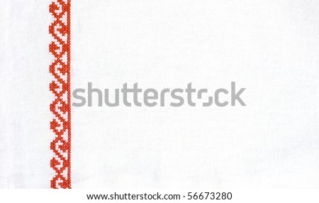 red cross stitch on wight fabric - stock photo