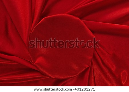 Red crumpled velvet with smooth round plot as background. - stock photo