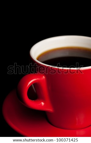 Red cup isolated on a black background