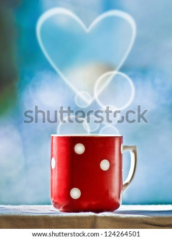 Red cup of coffee with dream smoke on blue background - stock photo
