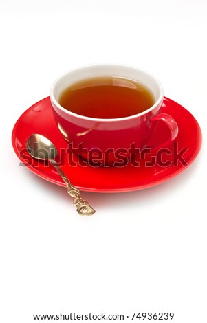 Red cup of tea on a white background - stock photo