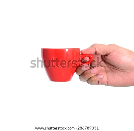 Red cup of tea or coffee in hand on white background