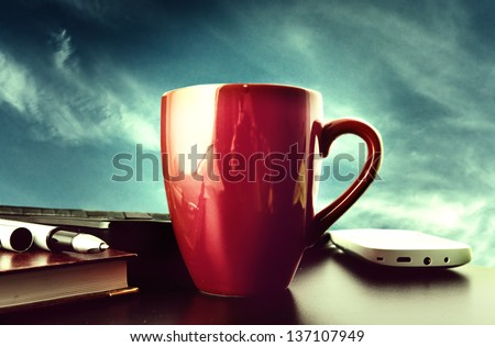 red cup on a background of blue sky - stock photo