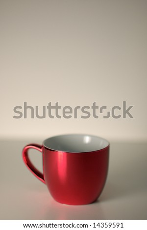 Red cup semi-isolated - stock photo