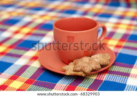 red cup with a heap of cookies - stock photo