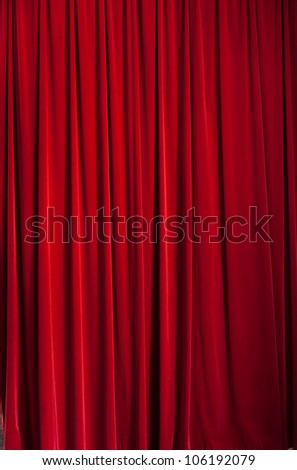 Red curtain ideal for backgrounds and textures - stock photo