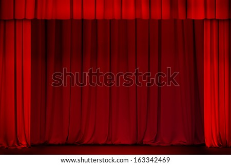 red curtain on theater or cinema stage wide open - stock photo