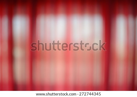 Red curtain that is lighted by the sun - stock photo
