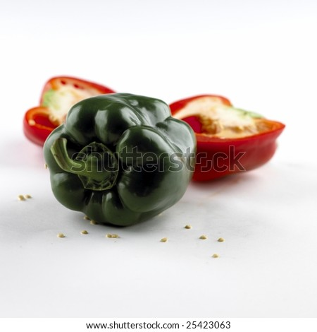 Red cut Paprica and a green paprica isolated on white background - stock photo