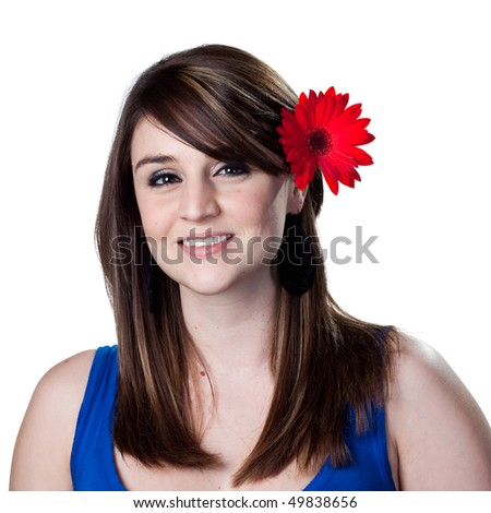 Red daisy in the hair of a beatiful young woman - stock photo