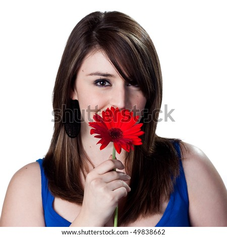 red daisy in the hands of this woman - stock photo