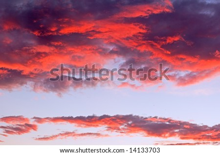 Red dark clouds lit by setting sun