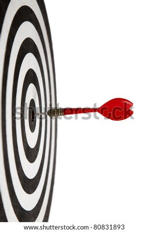 Red Dart hitting the middle of dartboard - stock photo