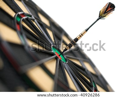 red dart on bullseye isolated on white background - stock photo