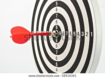 Red dart struck directly in center of target - stock photo