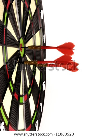 red darts hitting a target board, concept for business success and marketing - stock photo